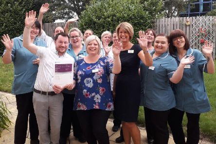 Staff at the care home celebrate the 'Good' overall rating.