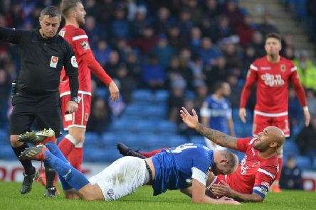 Courtney Meppen-Walter concedes a free-kick against Chesterfield