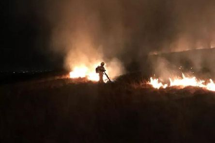 Firefighters battled to contain a moorland blaze at Winter Hill on Saturday,March 23. Pic - Shaun Walton.