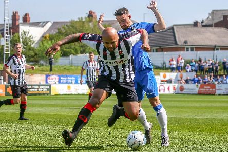Courtney Meppen-Walter in action for Chorley against Stockport County. Photo credit: Stefan Willoughby.