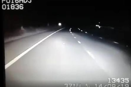 Police footage shows a man running down the hard shoulder of the M61 near Chorley at 12.30am this morning (August 14). Can you spot him? Credit: Lancs Road Police