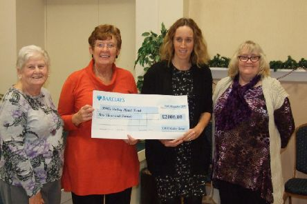 Big-hearted members of St Michael and St John's Church Ladies Group present cheque to Dr Lucy Astle