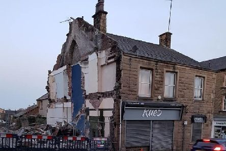 The gaping hole left by the demolition.