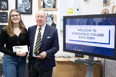 Frank Gorman presents a cheque to sixth form student Lucy Herbert.