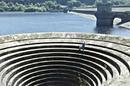 Andy poses on the edge of the plug hole at Ladybower Reservoir