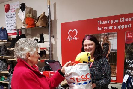 Jill, who works at the Chesterfield store, happily receives bags of donations from Jackie Alton, from Chesterfield.