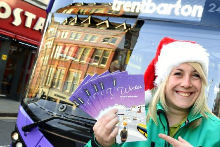 Kylie Pyke-Smart from Trentbarton customer services promoting the Christmas and new year timetables. Photo: Lionel Heap.