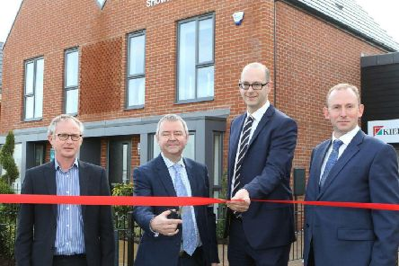 Martin Bessant, regional director at Kier Living, and Barry Cummins, of Homes England, are joined by councillors Graham Hill and Bryan Harrison for the official opening of the show homes at the development of the former Avenue coking plant. Picture by Jason Chadwick.