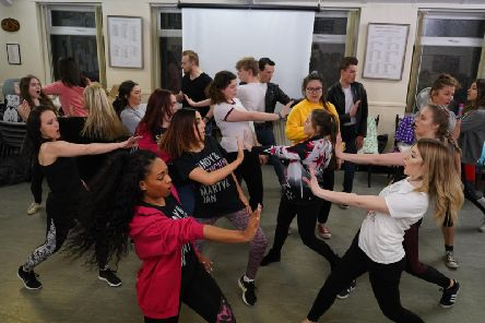Members of Chesterfield Operatic Society rehearse for Grease.