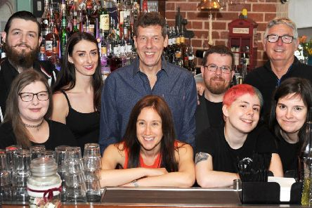 Staff at Chandlers celebrates the bar's 20th birthday.
