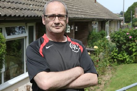 Tom Hay and the row of bungalows where he lives which are plagued by mice