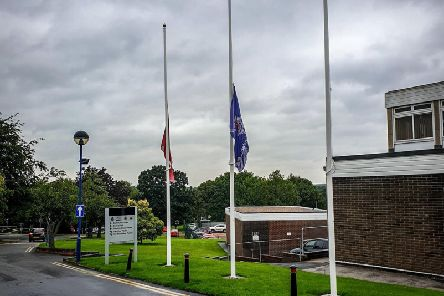 Flags at Derbyshire police HQare being flown at half mast as a mark of respect. Picture by Derbyshire police.
