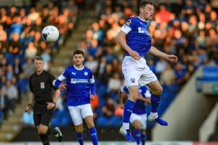 Picture John Hobson/AHPIX LTD, Football, National League, Chesterfield v Woking, Proact Stadium, Chesterfield, UK, 13/08/19, K.O 7.45pm''Chesterfields Hayden Hollis rises to head clear''Howard Roe>>>>>>>07973739229