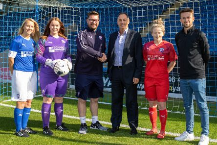 Chesterfield FC Women's Becky Bryan, Nic Watson and Gina Camfield with (L-R) CFCW chairman Keith Jackson, Chesterfield FC company secretary Ashley Carson and CFCW manager Mike Noon. Pic by Tina Jenner.
