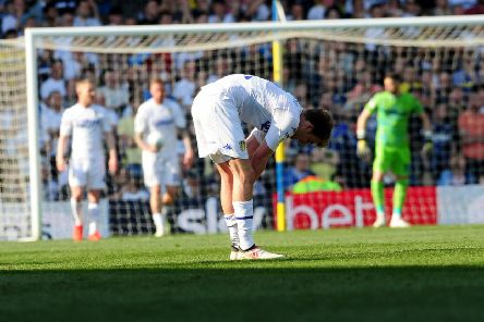 Dejected Patrick Bamford at the end of Leeds United's 2-1 defeat to Wigan. Picture: Simon Hulme