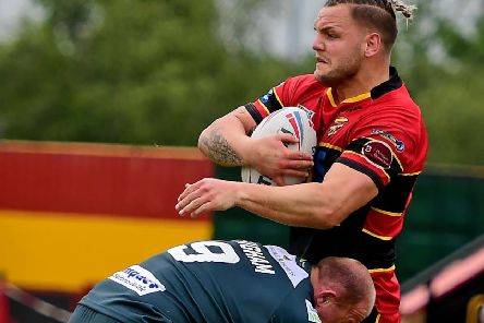 Leigh's veteran hooker Micky Higham halts a run from Dewsbury's Kyle Trout as the visitors nilled the Rams on their way to recording victory last Sunday. Picture: Paul Butterfield