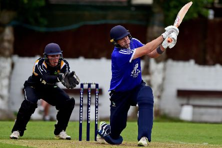 Hanging Heaton's David Stiff plunders one of his six sixes during last Sunday's ECB National Twenty20 Cup quarter final defeat to Sheffield Collegiate. Picture: Paul Butterfield
