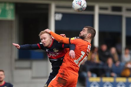 Ali Crawford is wrestled off the ball by Luton's Elliot Lee