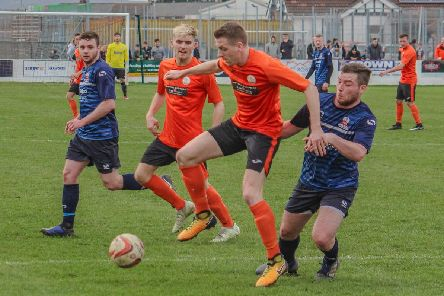 Action from Harworth Colliery's win over Shirebrook Town