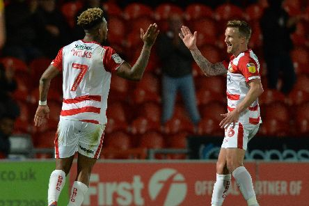 Mallik Wilks and James Coppinger celebrate a goal in the win over Bristol Rovers. Picture: Bruce Rollinson