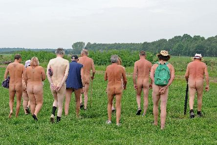 People attending Nudestock go for a walk.