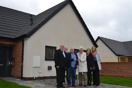 Mayor Ros Jones hands David Coates the keys to his new bungalow in Balby