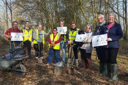 Volunteers brightening up the Brinsley Headstocks site with woodland wildflowers.