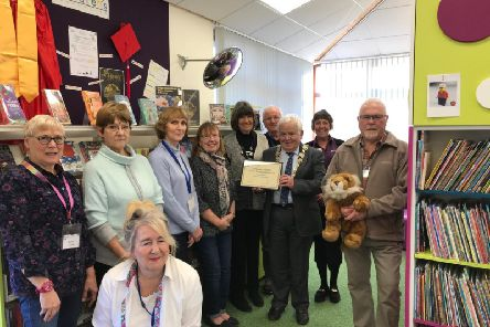 Library staff and volunteers at Filey library receive a Summer Reading Challenge award from Cllr Jim Clark.
