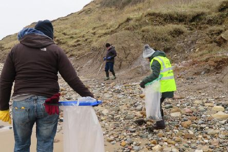 Cleaning the beach at Filey.