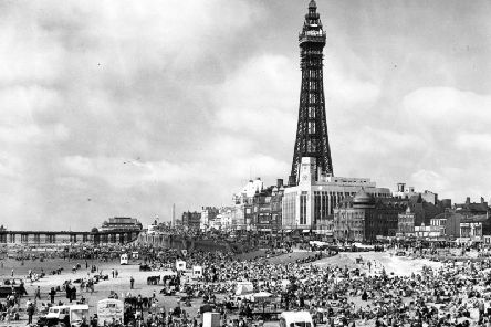 Crowds of holiday-makers on the beach at Blackpool, Lancashire, dominated by the Blackpool Tower on July 18, 1951