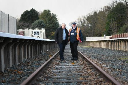 Prime Minister Boris Johnson (left) during a visit to Thornton-Cleveleys Railway Station, on the disused Fleetwood and Poulton-le-Fylde line while General Election campaigning.