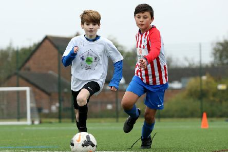 Local children take part in activities during a Premier League Football Foundation Hub Opening at Jericho Lane Playing Fields on October 31, 2019 in Liverpool, England. (Photo by Jan Kruger/Getty Images for Premier League)
