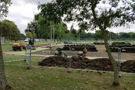 Workmen laying the new pitch at Stanley Park last year, before they were opened by Man Utd defender Rio Ferdinand