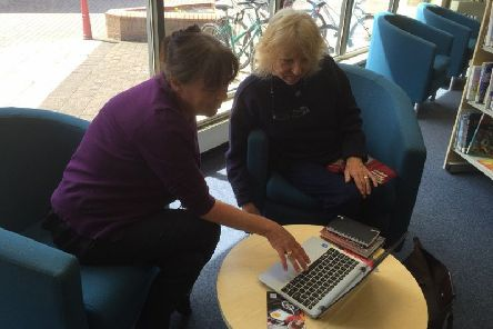 Providing help with IT is one of the activities on offer during National Libraries Week.