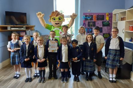 Handel House School pupil's are pictured with the Recycle with Michael mascot