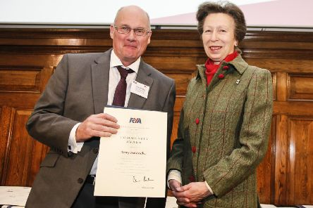 Tony Baldock receives his lifetime commitment award from Princess Anne. (PHOTO BY: Paul Wyeth)