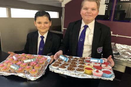 John Brocklesby, 13, a Year 8 student council member is pictured with Ollie White Year 8 president.