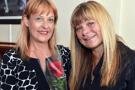 Linda Foy is presented the Guardian Rose by Lisa Sprowell.