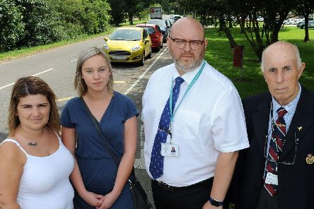 Parents, Kayleigh Kay, left and Kelly Geeson, are joined by head teacher, Gary Brown and Coun. Keith Panter, right, who are supporting their campaign for traffic calming measures outside the Castle Wood Academy in Gainsborough.