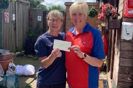 A cheque for 600 is presented to Elaine Shaw from Notts Super Dogs