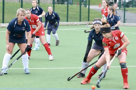 Garstang Hockey Club's Harriet Price on the attack as Steph Roe and Orla McShannon await the ball
