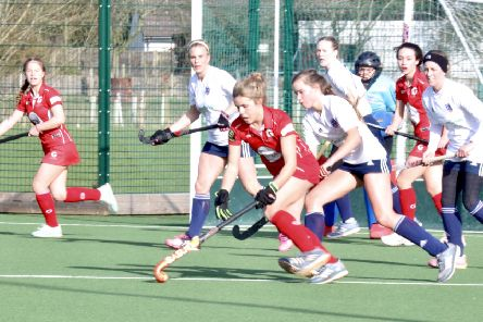 Garstang Hockey Club's Di Metcalf, supported by Lucy Treaddell and Summer Muirhead