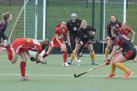 Garstang Hockey Club's Libby Baxter attempts to find Minnie Rogers and Summer Muirhead