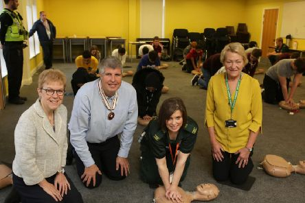 School governors Lynnette Cassidy, Neil Davidson and Francis Millington, with Helen Byrnes from Yorkshire Ambulance Service, for the Re-start a Heart event, at  Crossley Heath School, Halifax