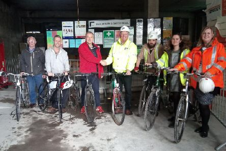David Fawcett of Happy Days Cycles with Alistair Clarke of Blacc Ltd, Janet Whitlow of Calderdale Council and some of the other staff who donated bikes