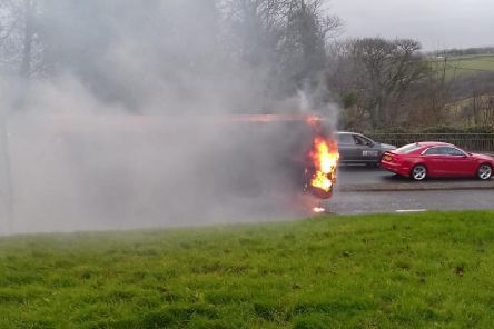 The Yorkshire Tiger bus on fire. (Picture Garry Williams)