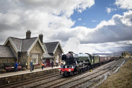 The Flying Scotsman passes Ribblehead station in the Yorkshire Dales.