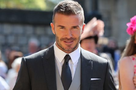 Former England footballer David Beckham has a 10 per cent stake in National League club Salford City. Photo by GARETH FULLER/AFP/Getty Images)