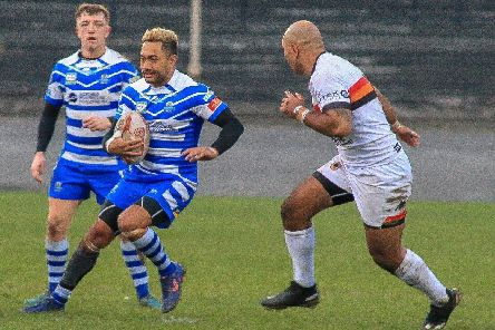 Halifax's Quentin Laulu-Togaga'e goes head-to-head withBradford Bulls' Jake Webster during the Yorkshire Cup. PIC: Simon Hall.