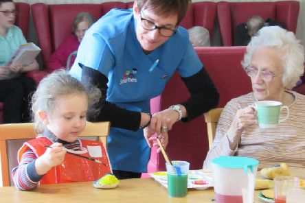 Smarties Nursery manager, Calire Gibson with a Smarties nursery-goer and care home resident
